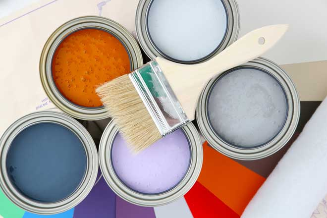 Cans of Paint and Paint Brush