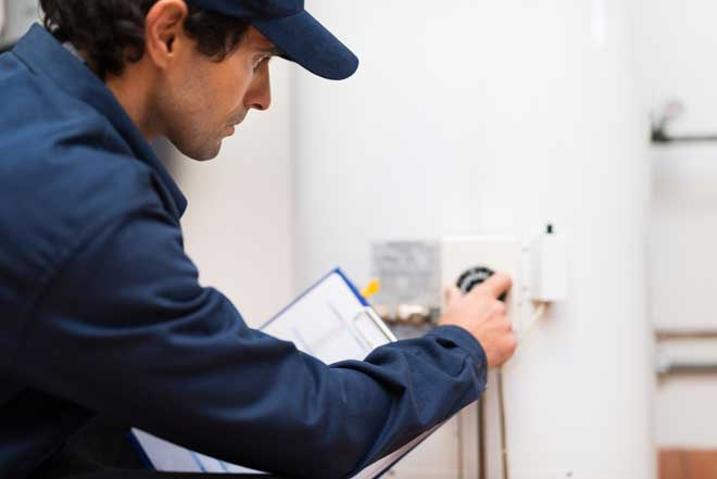 Technician Checking Water Heater