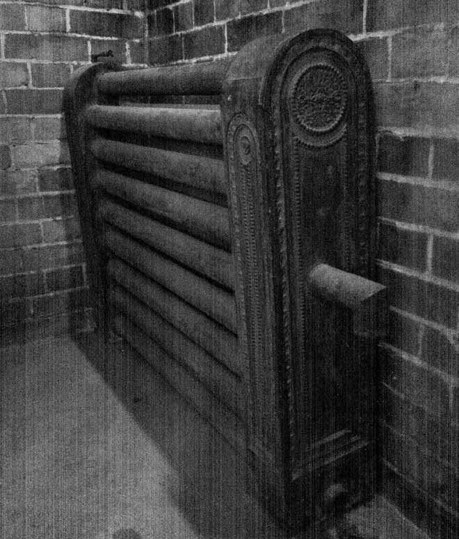 Victorian Radiator Next to Brick Wall