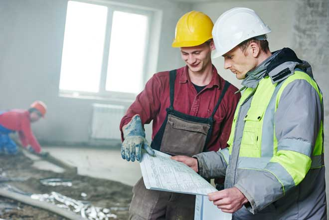 Construction Manager Giving Instructions to Worker