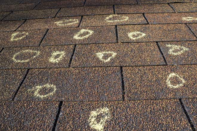 Hail Damage Marked on Roof by Claims Adjuster