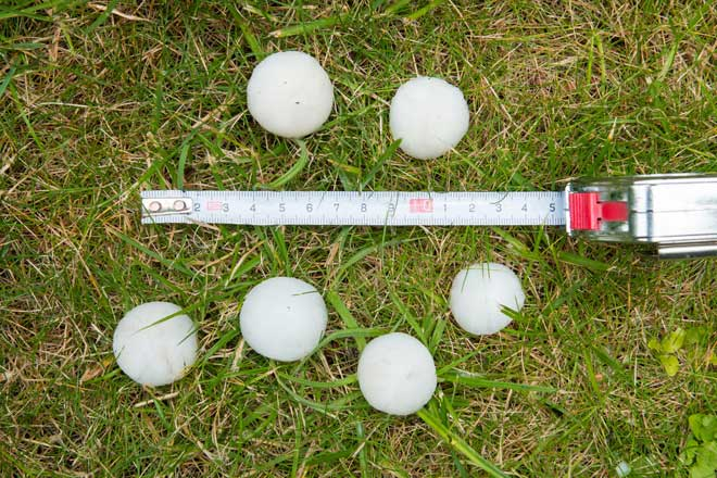 Large Hailstones Next to a Tape Measure