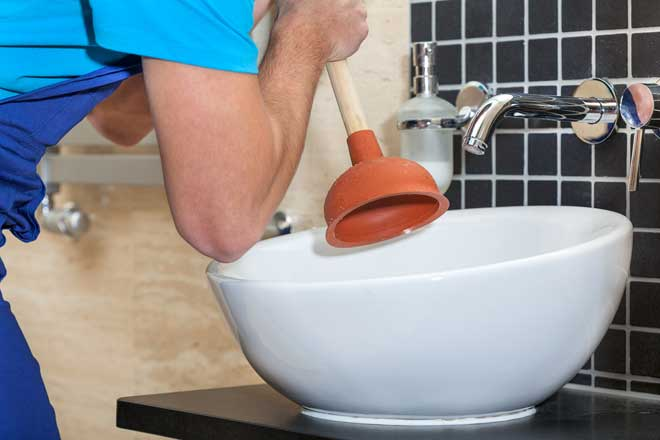 Plumber Plunging Bathroom Sink