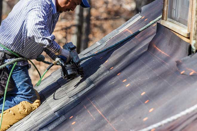 Roofer Installs Shingles Over Underlayment