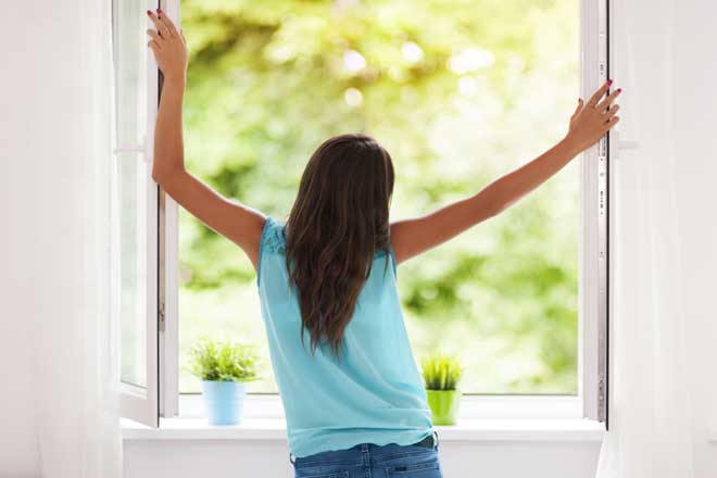 Woman Opening Home Window