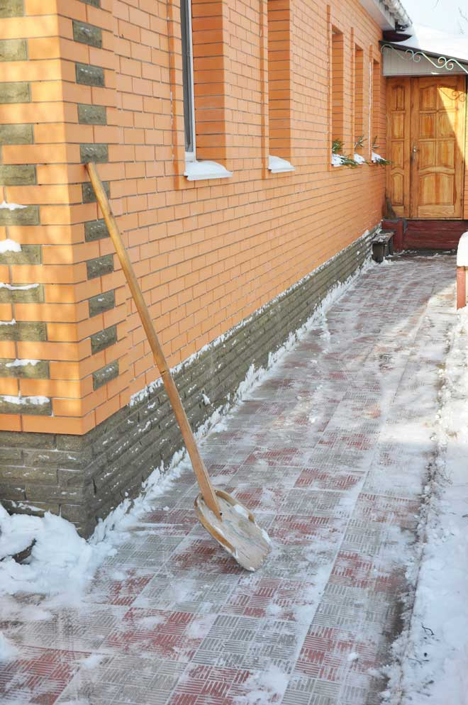 Clearing Snow from Home Walkway