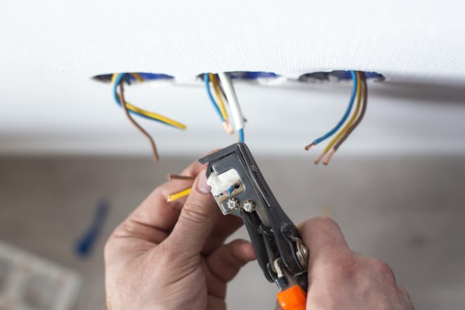 Electrician Stripping Wires