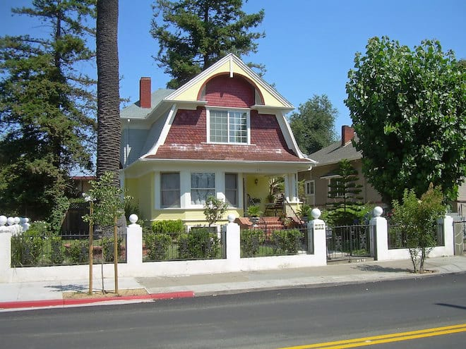 Yellow Dutch Colonial Revival