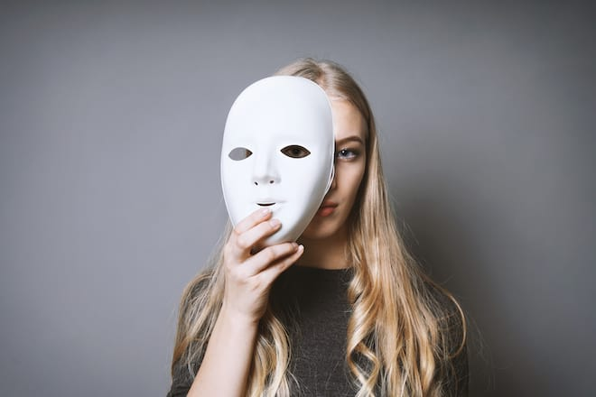Woman Taking off Mask