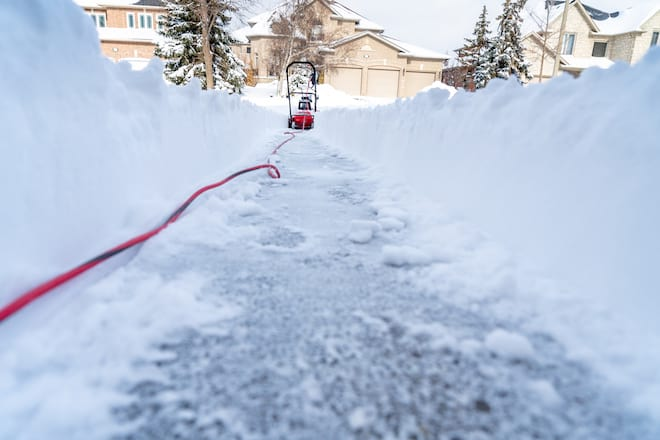 Electric Snow Blower Clearing Snow