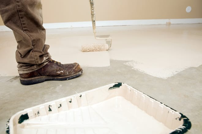 Man Applying Epoxy to Floor with a Roller
