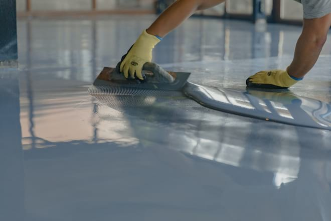 Man Covering Floor with Gray Epoxy